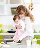Mother and her little daughter using tablet pc Royalty Free Stock Images
