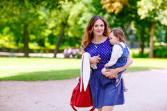 Mother and her little daughter walking in summer Stock Photos