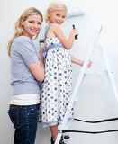 Mother and her little girl painting a room Royalty Free Stock Photos