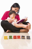 Mother and her little girl reading book Royalty Free Stock Photo