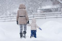 Mother with her little girl in snow Stock Photo
