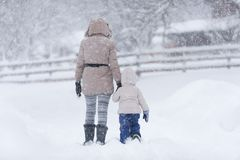 Mother with her little girl in snow Stock Photos