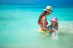 Mother with her little kid have fun on summer Stock Images