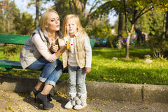 Mother and her little kid with soap bubbles Royalty Free Stock Image