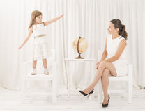 Mother and her little lovely daughter having fun playing Royalty Free Stock Photos