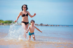 Mother and her little son on the beach Stock Photography