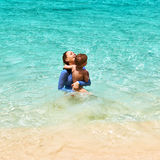 Mother and her little son at beach Royalty Free Stock Image