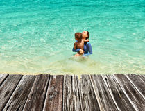 Mother and her little son at the beach Stock Photos