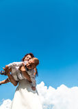 Mother with her little son on the blue sky behind Stock Photos