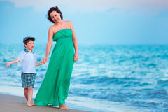 Mother and her little son enjoying beach Royalty Free Stock Image