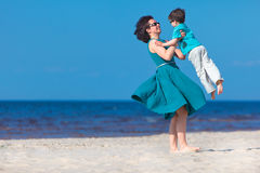 Mother and her little son enjoying beach Stock Photos