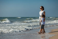 Mother and her little son enjoying beach Royalty Free Stock Photos