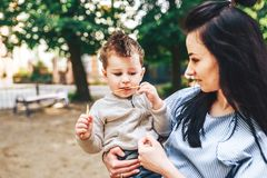 Mother with her little son outdoor in the park. Young mother with her little son outdoor in the park stock image
