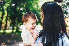 Mother with her little son outdoor in the park. Young mother with her little son outdoor in the park stock photo