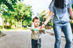 Mother with her little son outdoor in the park. Young mother with her little son outdoor in the park royalty free stock photos