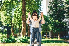 Mother with her little son outdoor in the park. Young mother with her little son outdoor in the park stock photography