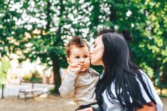 Mother with her little son outdoor in the park. Young mother with her little son outdoor in the park stock photos