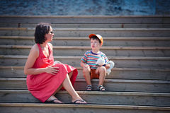 Mother and her little son outdoors in city Stock Photo
