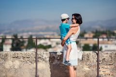 Mother and her little son outdoors in city Royalty Free Stock Image