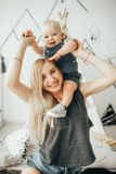 Mother with her little son plays in room. stock image