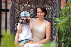 Mother and her little son with retro camera Royalty Free Stock Image