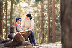 Mother and her little son sitting on a bench Royalty Free Stock Photo