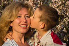Mother and her little son in a spring garden Stock Photos