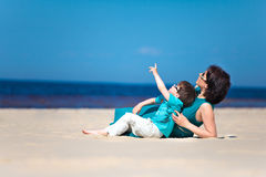 Mother and her little son together at beach Royalty Free Stock Photography