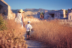 Mother and her little son walking in ancient city Royalty Free Stock Image