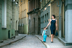 Mother and her little son walking in city Royalty Free Stock Photography