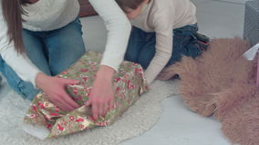 Mother and her little son wrapping up Christmas presents at home stock footage