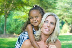 A mother and her mixed race daughter Stock Photography