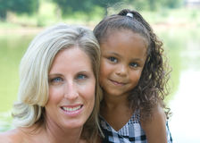 A mother and her mixed race daughter. Enjoying the park Royalty Free Stock Photo