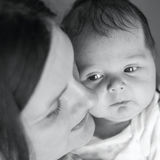 Mother with her newborn baby. Black white photography, mother an Royalty Free Stock Images