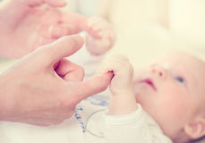 Mother and her newborn baby Stock Images