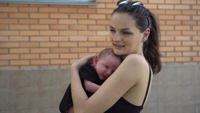 Mother and her Newborn Baby. Happy Mother holding her Baby. Maternity concept. stock video
