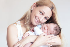 Mother and her Newborn Baby Royalty Free Stock Photos