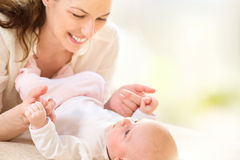 Mother and her newborn baby Stock Photos
