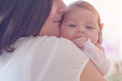 Mother with her newborn baby. Mother is holding her little baby stock photography