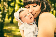 Mother and her newborn baby outdoor in the park Stock Photo