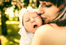 Mother and her newborn baby outdoor in the park Stock Photos