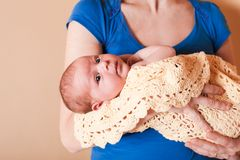 Mother with her newborn baby Stock Images