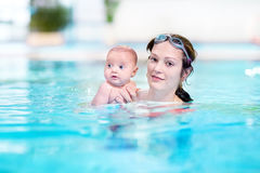 Mother and her newborn baby in swimming pool Royalty Free Stock Photography