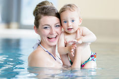 Mother and her newborn child at infant swimming class Royalty Free Stock Photography