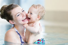 Mother and her newborn child at infant swimming class Stock Photo
