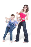 Mother and her oldest son hold younger brother Stock Photography