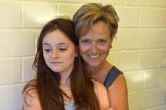 Mother and her pertly teenage daughter Stock Photography