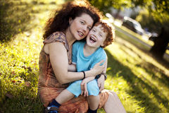 Mother and her red-haired son  in the park Royalty Free Stock Image