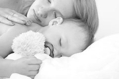 Mother and her sleeping child stock photography