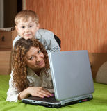 Mother with her son. Happy mother with her son with notebook computer Stock Images